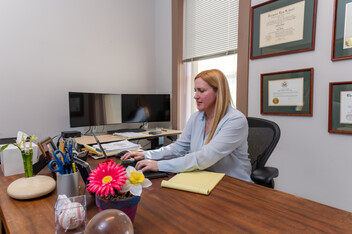 An attorney working at her desk